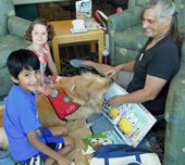 Volunteer and dog with kids