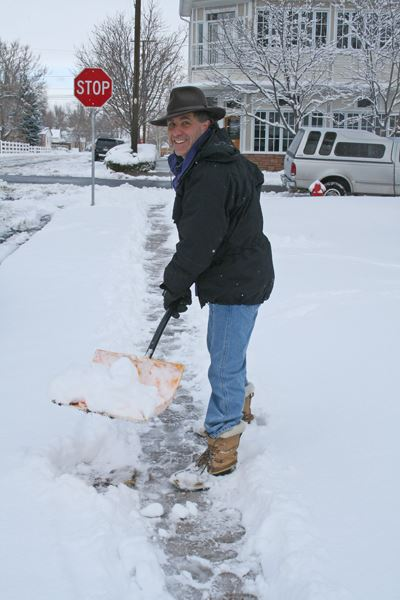 volunteer shoveling snow