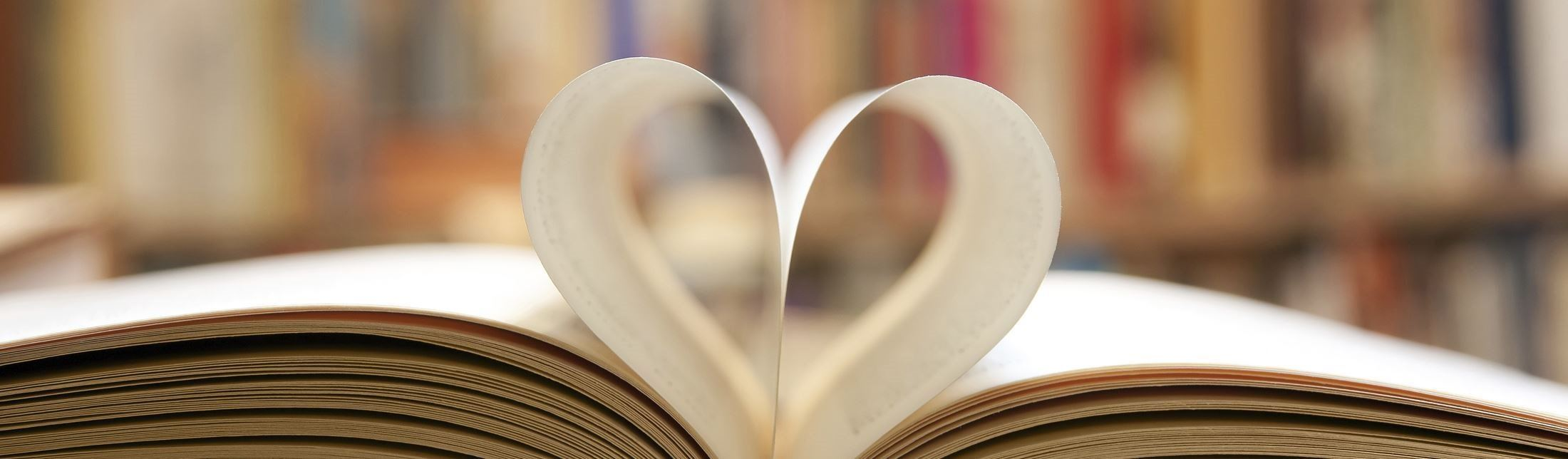 Pages of a book folded into heart