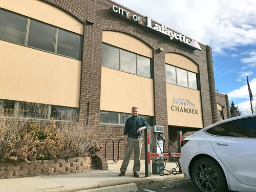 Tony Raeker pictured in front of the City Hall EV charging station
