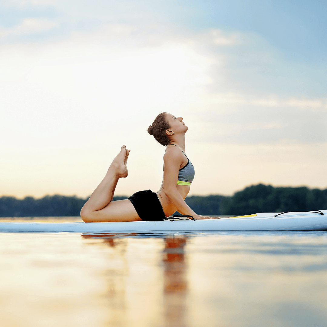 Image of girl on stand up paddleboard in a yoga pose