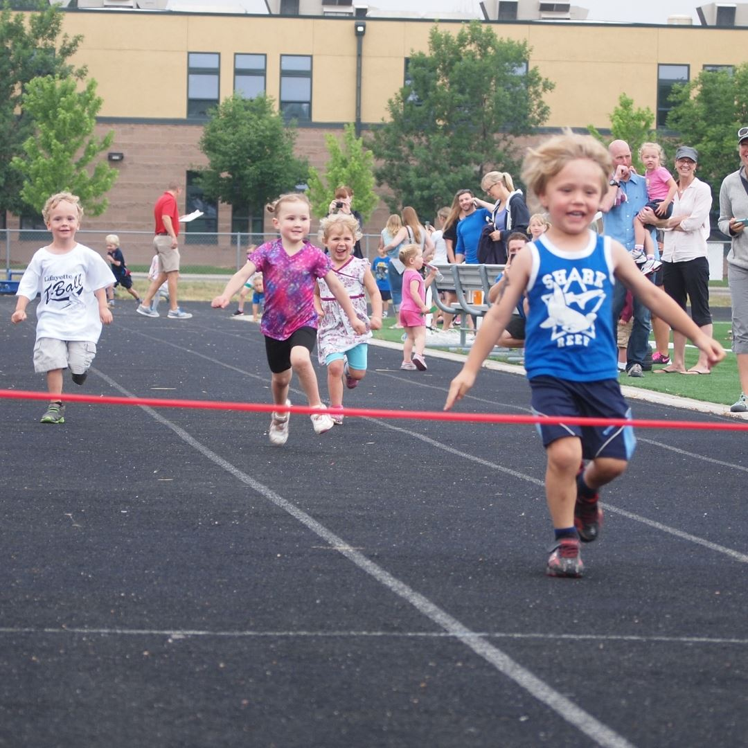 Image of children running towards a finish line