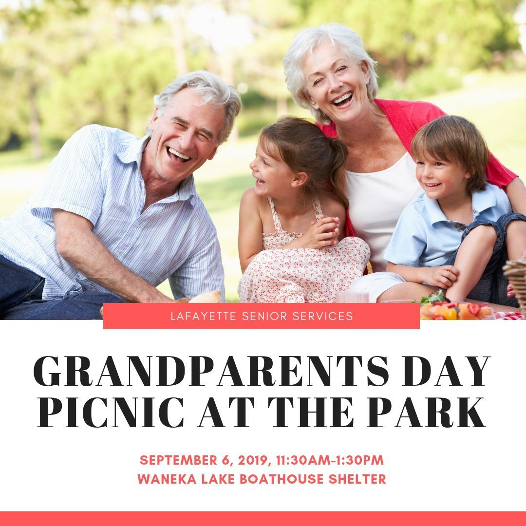 image of older couple laughing with grandchildren