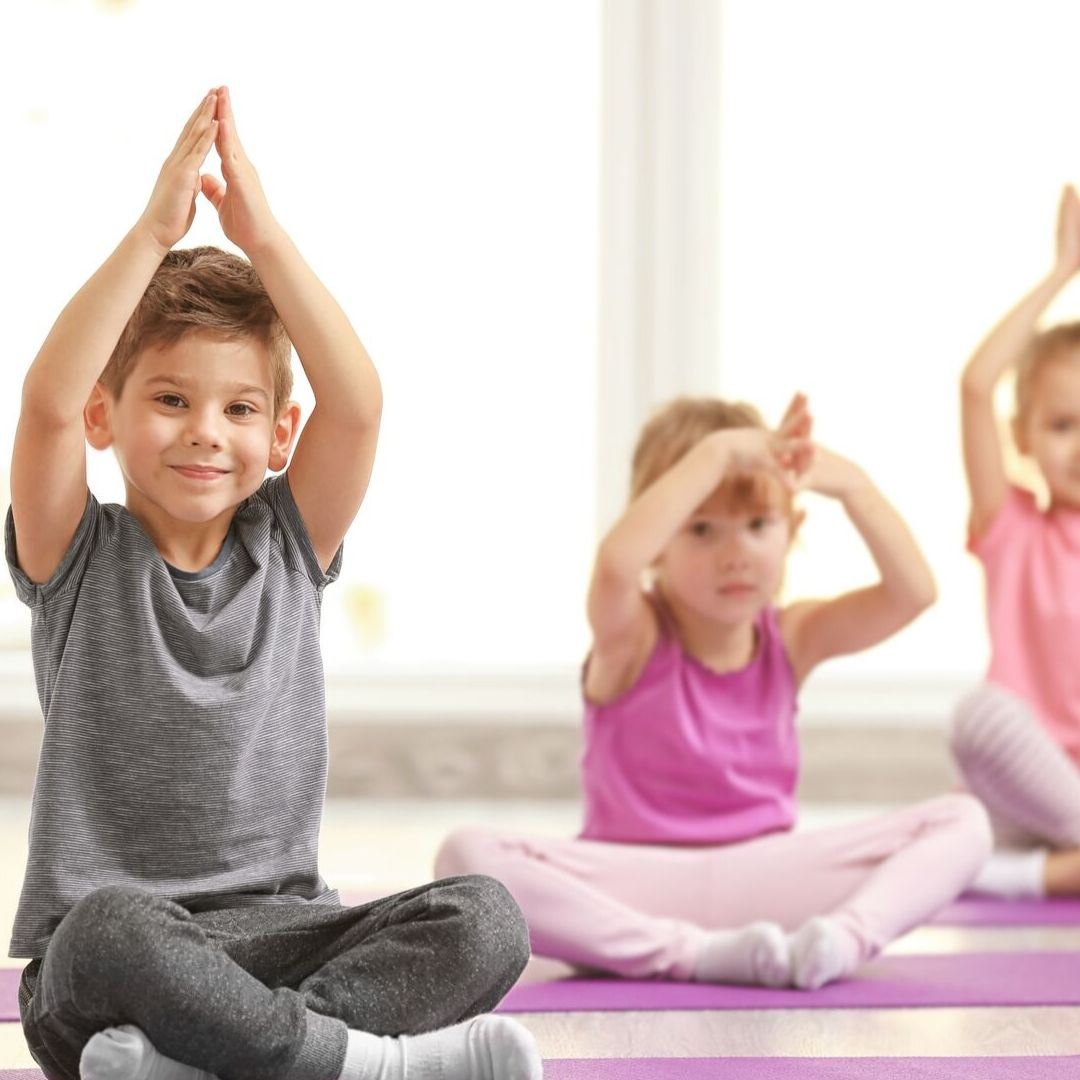 young children in yoga pose