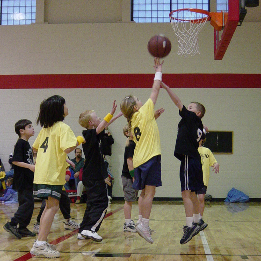 Young children playing basketball