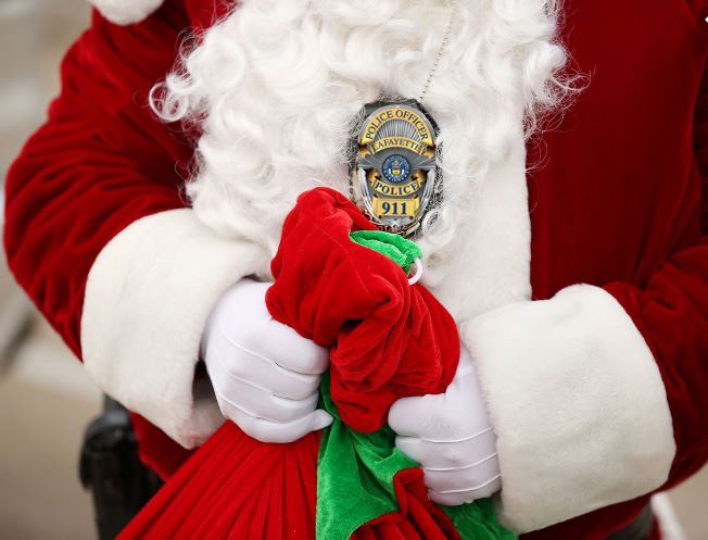 Santa with Lafayette Police badge and toy bag