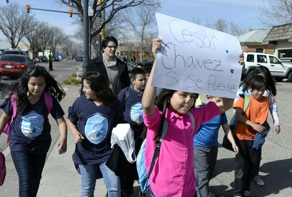 Image of young children marching with a Cesar Chavez sign.