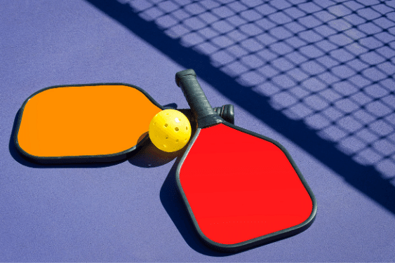 pickleball paddles and ball on floor