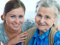 Senior lady with younger lady smiling