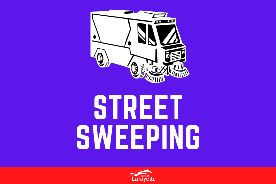 White street sweeping vehicle with blue background.