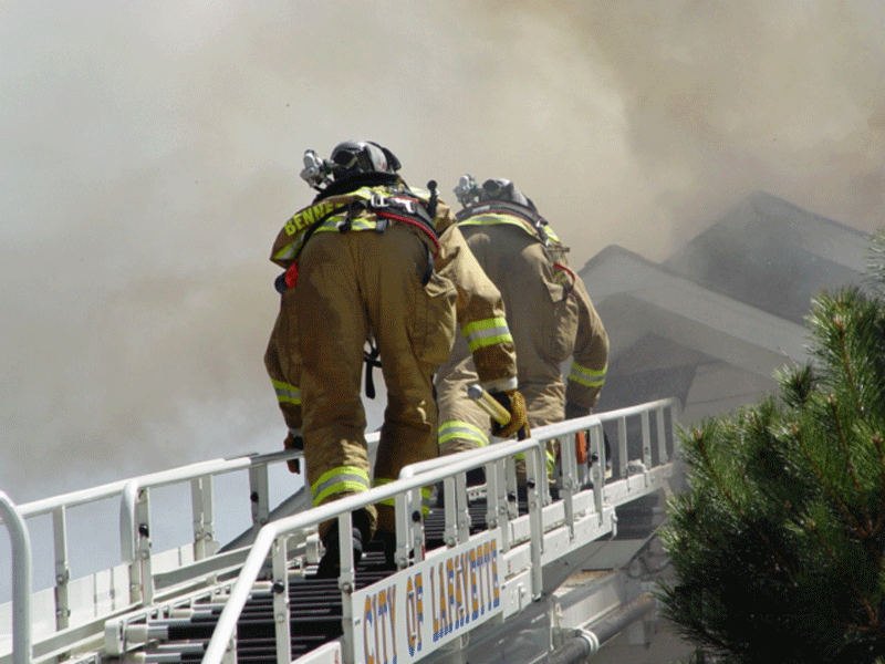 Laddering the roof of a fully involved house fire in 2006