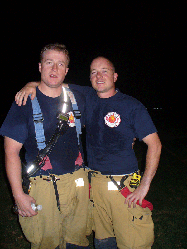 2007 boat house fire Kris Krekora and Travis Rohde after fire extinguished