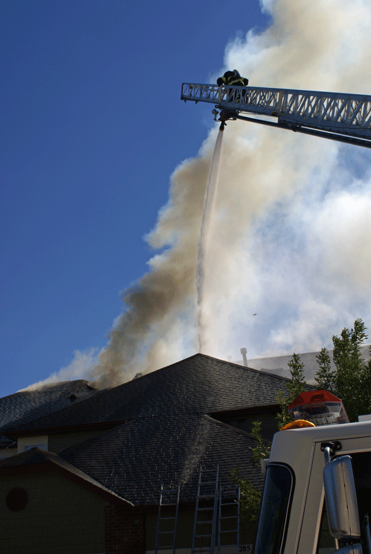 Multi-family dwelling fire in Superior. 2616 Rohde spraying water from deluge nozzle