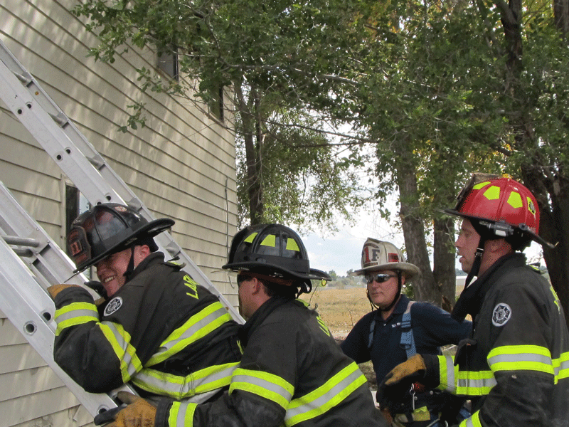Crew readying to climb ladder and do search