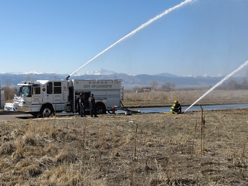 2012-Engineer training with deck gun and deluge gun flowing mountains in background