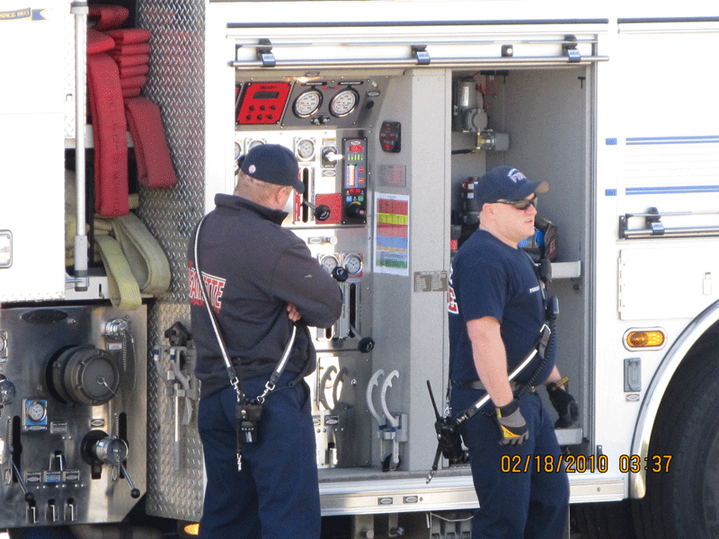 2012-Engineer Krekora and paramedic Brigham at pump panel