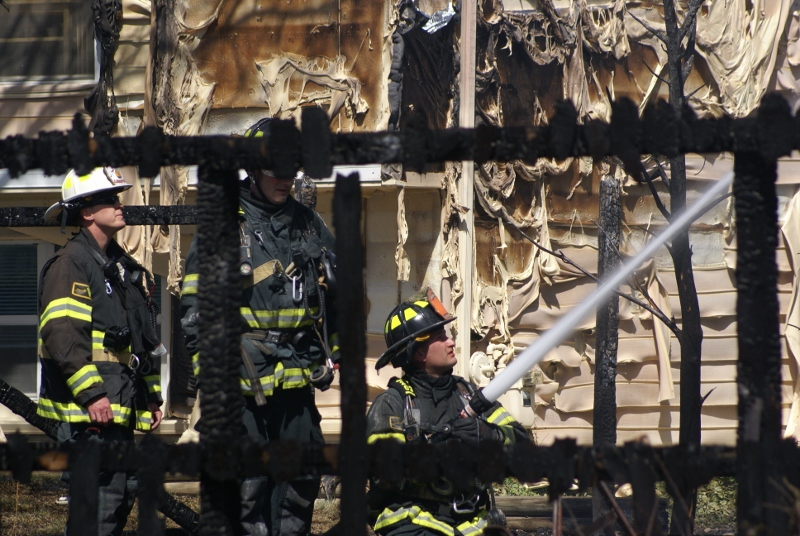 Bat. Chief Melvin and firefighters hosing down hot spots during overhaul