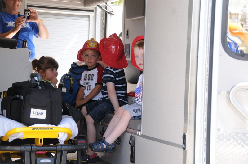 Kids sitting in back of ambulance during demonstration