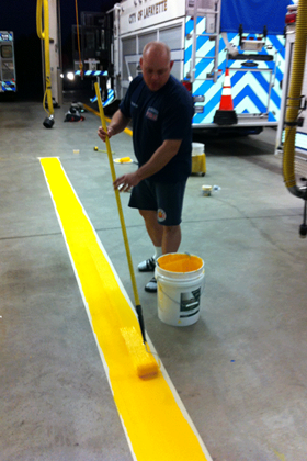 Chris Brown hard at work repainting the apparatus bay striping