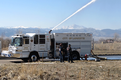 2012-Engineer training 2601 pumping out deck gun with mountains in the back ground