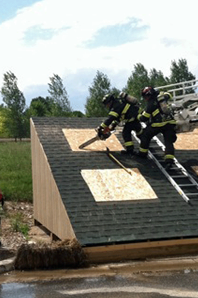 2012-roof training on new roof prop with chain saw and roof ladder