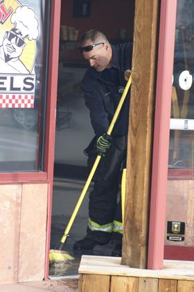 Lt. Garret doing overhaul after commercial fire
