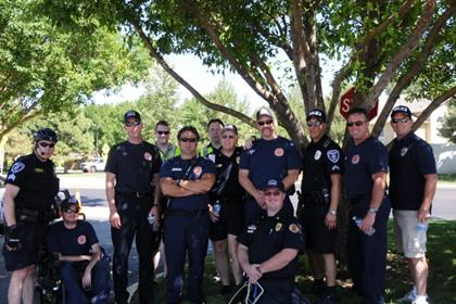 FD and PD crew posing under a tree at the safety days