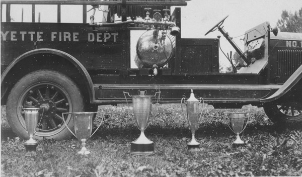 Fire truck with trophies in front