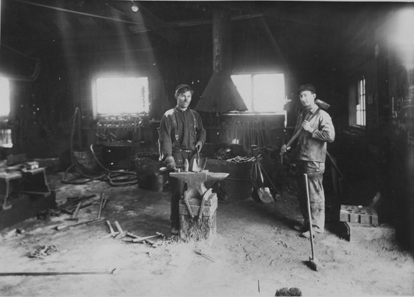 Tom Williams - Ray Noble, blacksmith shop, Simpson mine, 1917.