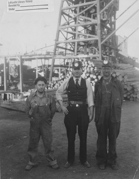 Three men in front of the Columbine mine tipple, Nov. 7, 1931
