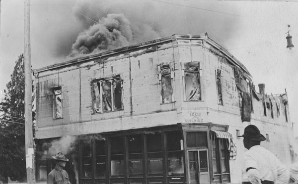 A man watches the W. H. Frantz store fire