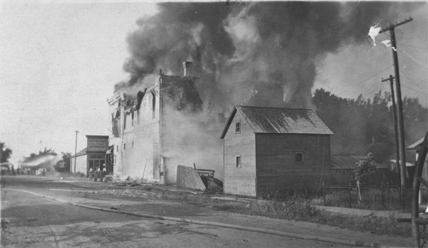 Rear view of the W. H. Frantz store burning