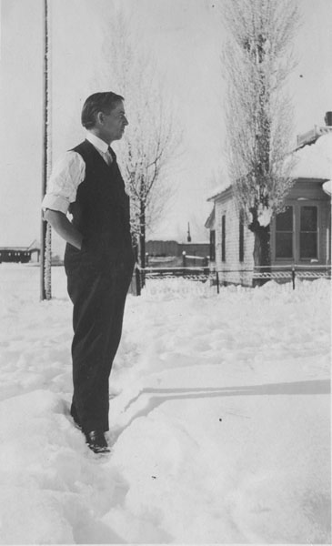 Mr. Gwinnup standing in the snow of the snowstorm in May, 1912