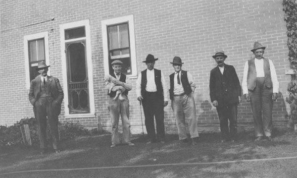 Six men standing outside of Lafayette's City Hall