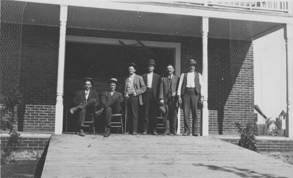 Six men on the front porch of the Lafayette City Hall