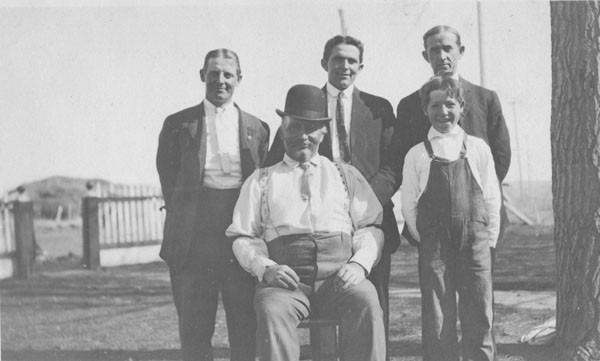 Ira Gwinnup with three other men and a boy