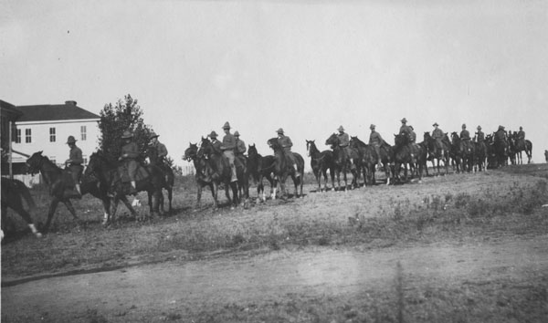 Soldiers riding in formation