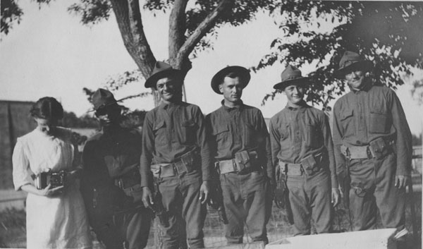 Five soldiers and one woman pose for a picture