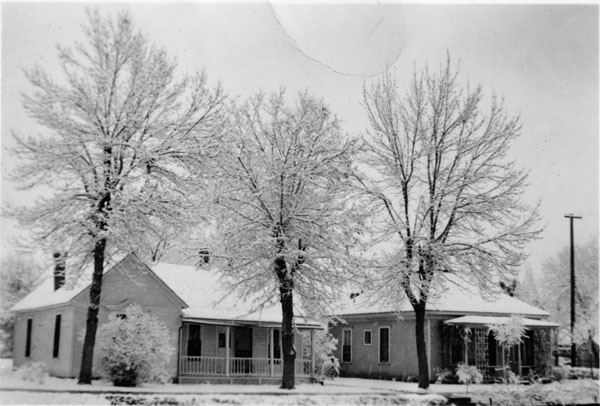 Houses at 107 and 109 E. Simpson Street in snow