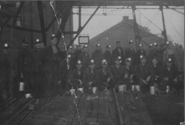 A group of miners under the tipple at the Hiway mine