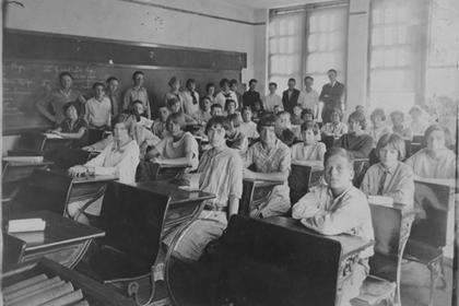 Lafayette school's eighth grade class, seated in class room.