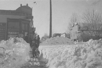 Shoveled sidewalk after snowstorm, Dec. 4, 1913