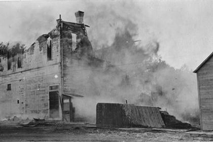 W. H. Frantz store burning, rear view