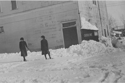 Two girls in the snow outside the Franz store