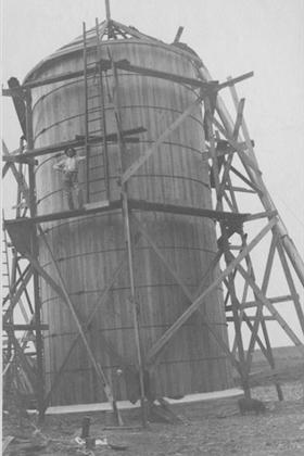 A wooden silo surrounded by scaffolding