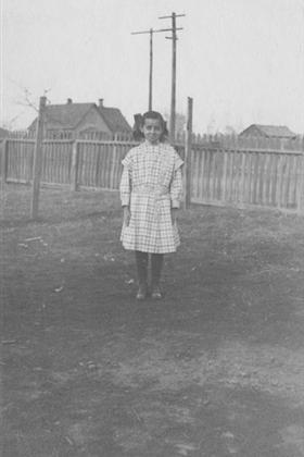 Ruth Gwinnup standing in a back yard