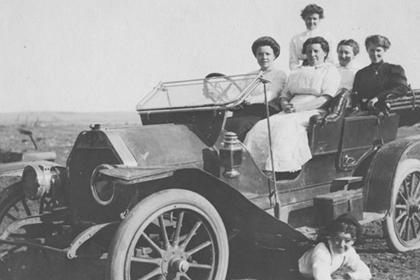 A group of women sitting in a car