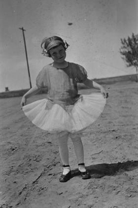 A young girl in a ballerina outfit