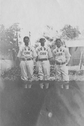 Three men in union baseball team uniforms standing in a yard