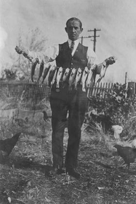 Ira Gwinnup holding a string of fish